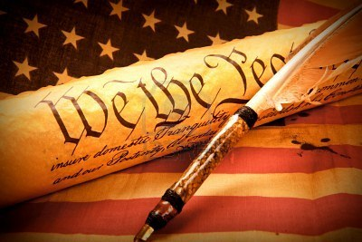 6791103-old-fashionet-american-constitution-we-the-people-with-usa-flag